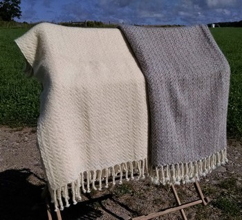 white and gray Cotswold blankets